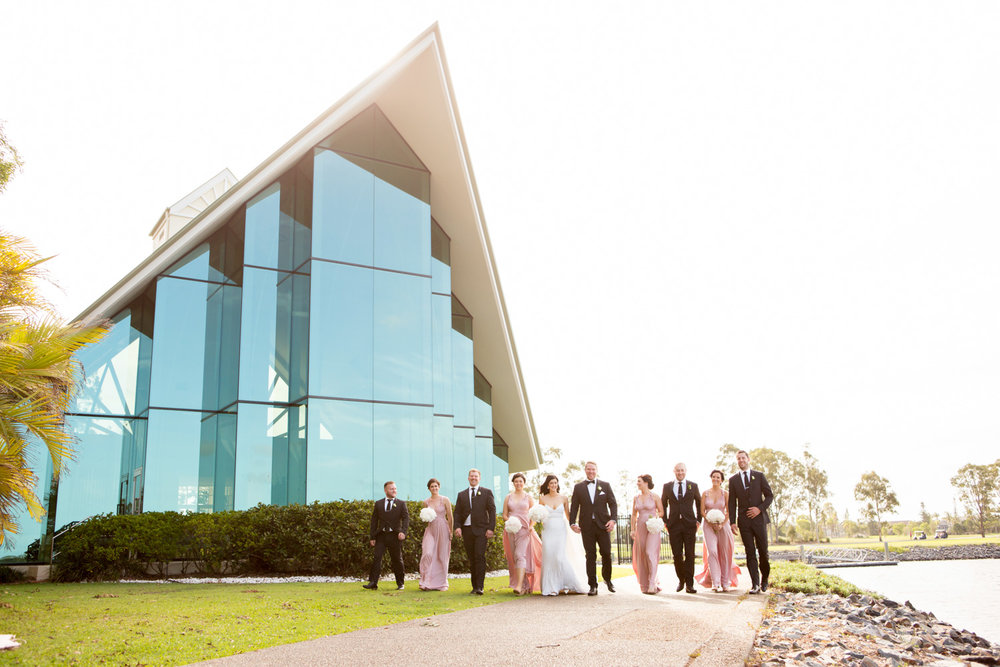 wedding-0212-bridalparty-walking-relaxed-pink-dresses-queensland.jpg