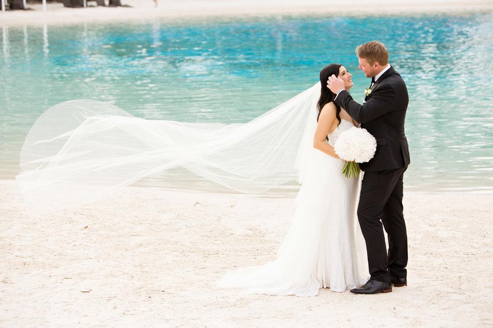 wedding-0216-veil-wind-blowing-pool-peonies-australia.jpg