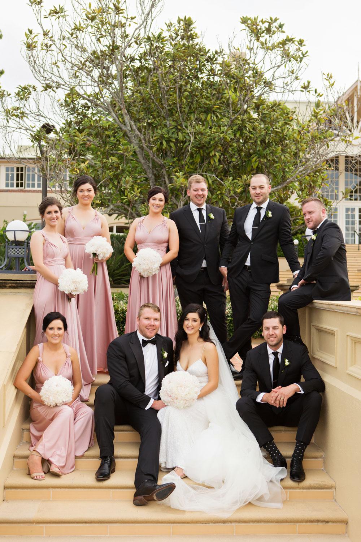 wedding-0220-bridalparty-sitting-pink-dresses-brisbane.jpg