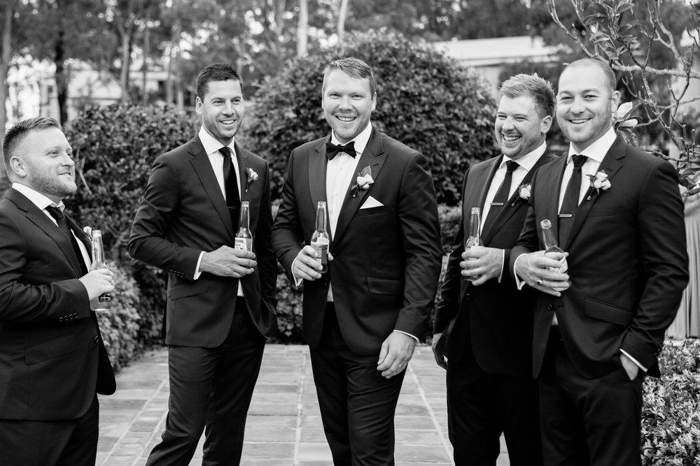 wedding-0225-groomsmen-dapper-drinks-laughter-natural-australia.jpg