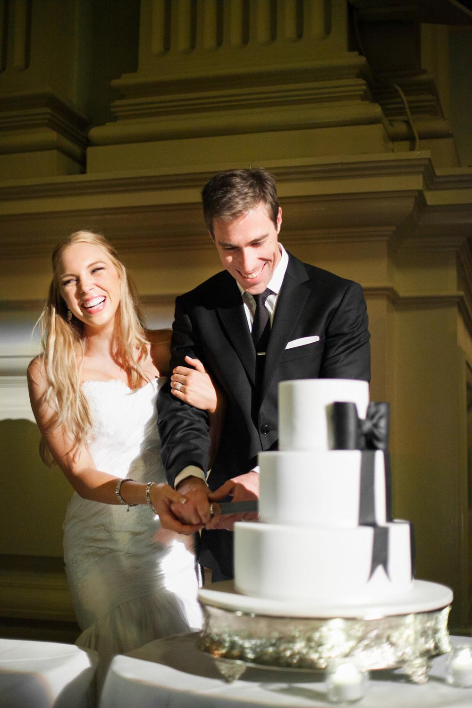 wedding-0296-cake-laughing-cutting-black-white-queensland.jpg