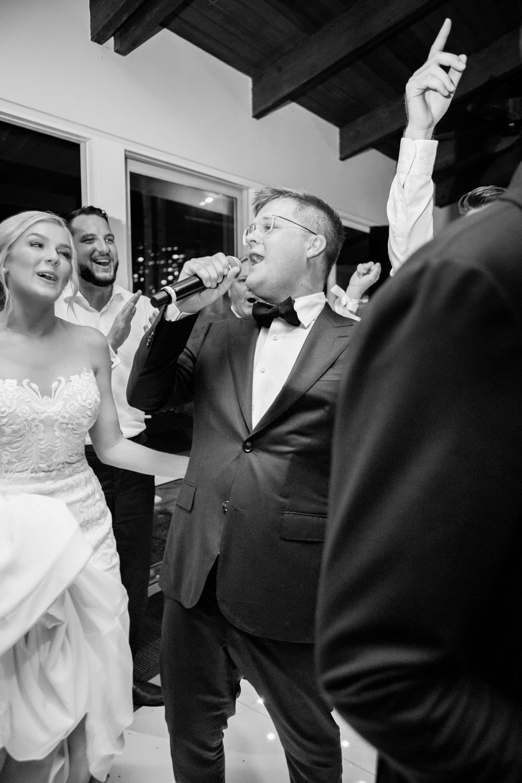 wedding-0161-outrigger-reception-party-singing-dancing-queensland.jpg