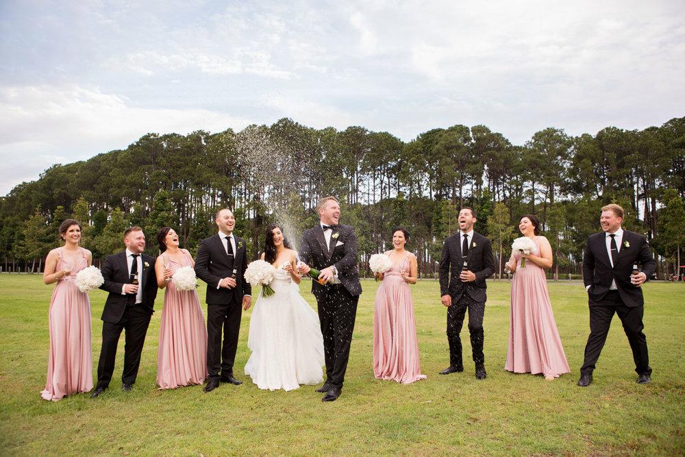 wedding-0234-champagne-spray-excited-drinks-bridalparty-australia.jpg