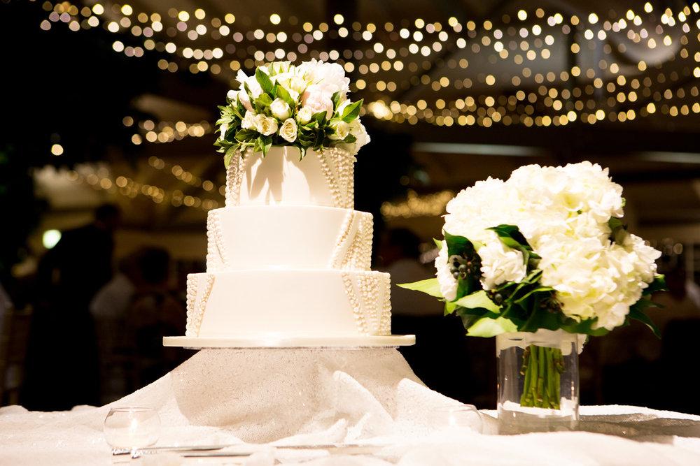 wedding-0241-reception-cake-flowers-fairylights-brisbane.jpg