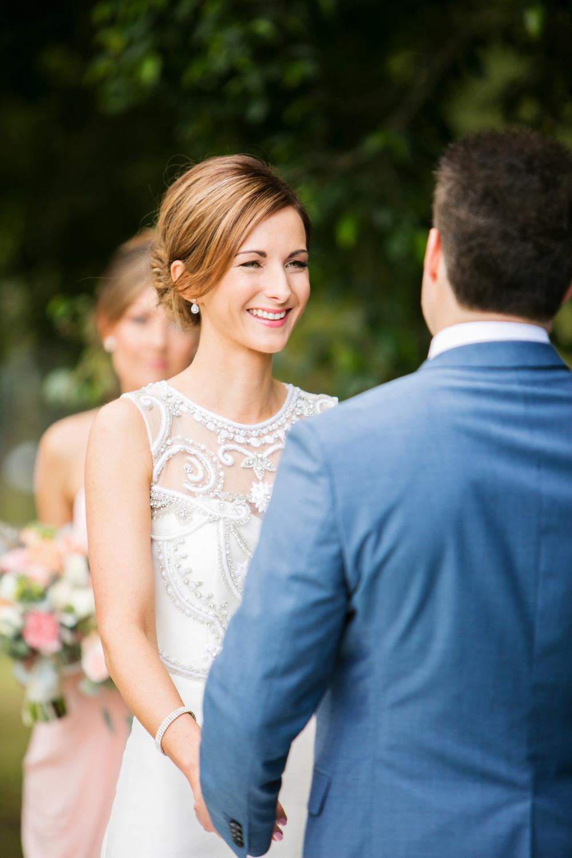 wedding-0478-happy-bride-ceremony-blue-suit-brisbane.jpg