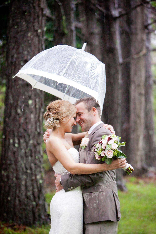 wedding-0491-rain-umbrella-laugh-fun-queensland.jpg