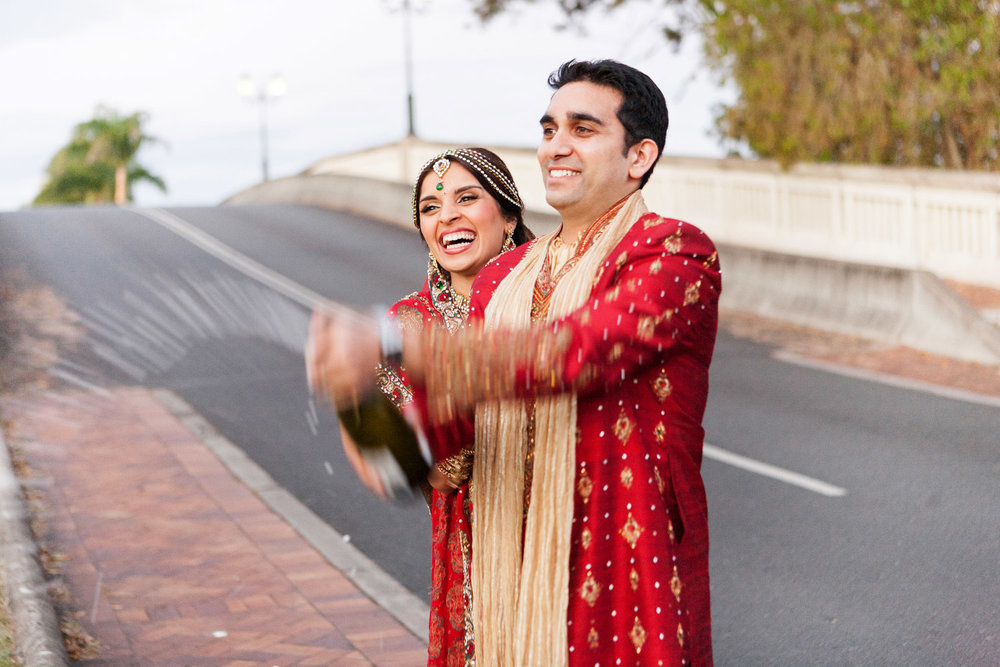 wedding-0391-indian-champagne-spray-excited-brisbane.jpg