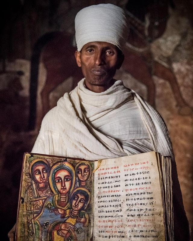 This is Haylesilassie Kahsay, he is the head priest at Abuna Yemata Guh. His church was carved out of a cliff face in the 6th century. The paintings are all original and well preserved despite the fact that the church is still active and holds services every Sunday as well as holidays, funerals and births. More photos to come. #Ethiopia