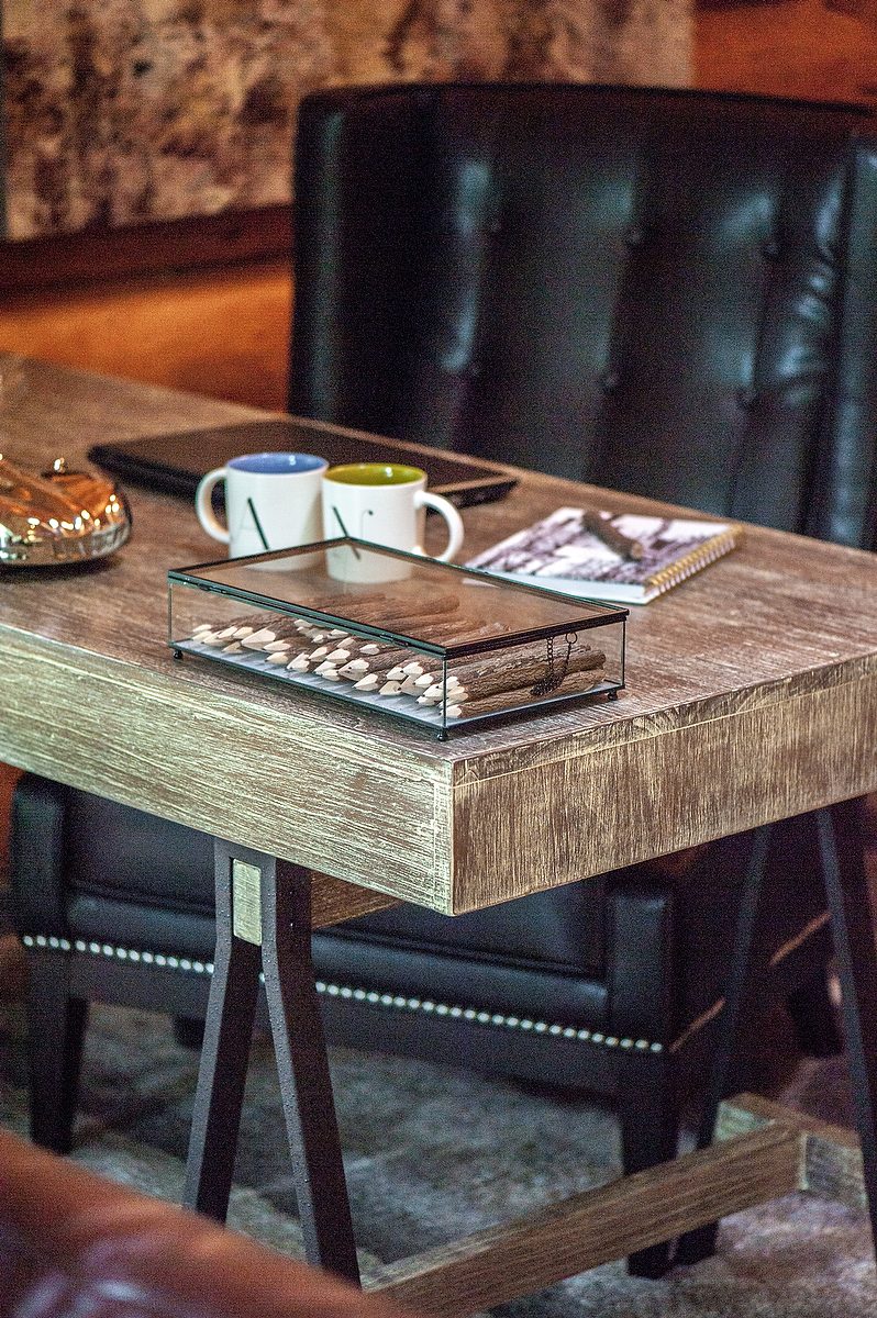It's all in the details - simple touches like this glass display of rustic pencils bring some personal charm to an office desk.