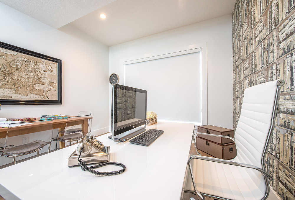 The office strikes the perfect balance of old world style with modern forms.