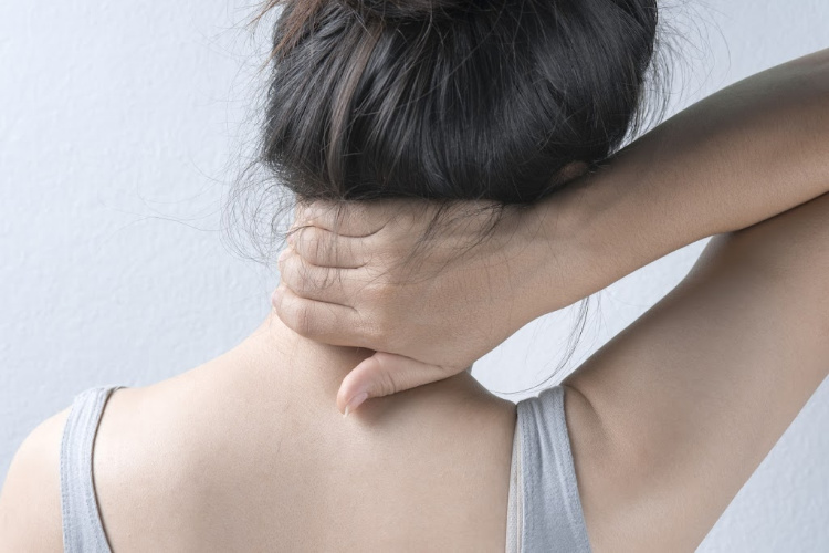 Myrcene - woman with neck pain