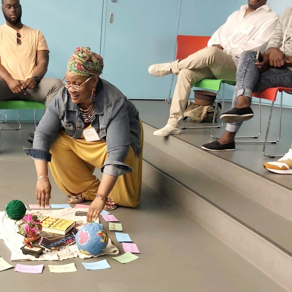 Facilitator Dionne Grayman prepares a community-building exercise