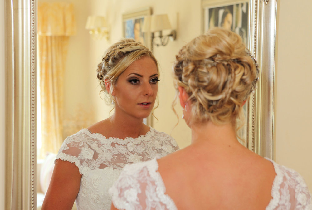 Bride_in_mirror_wedding photographer Edinburgh.jpg
