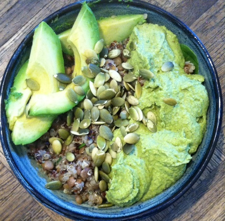 hummus, raw pumpkin seeds, lentils, and avocado slices