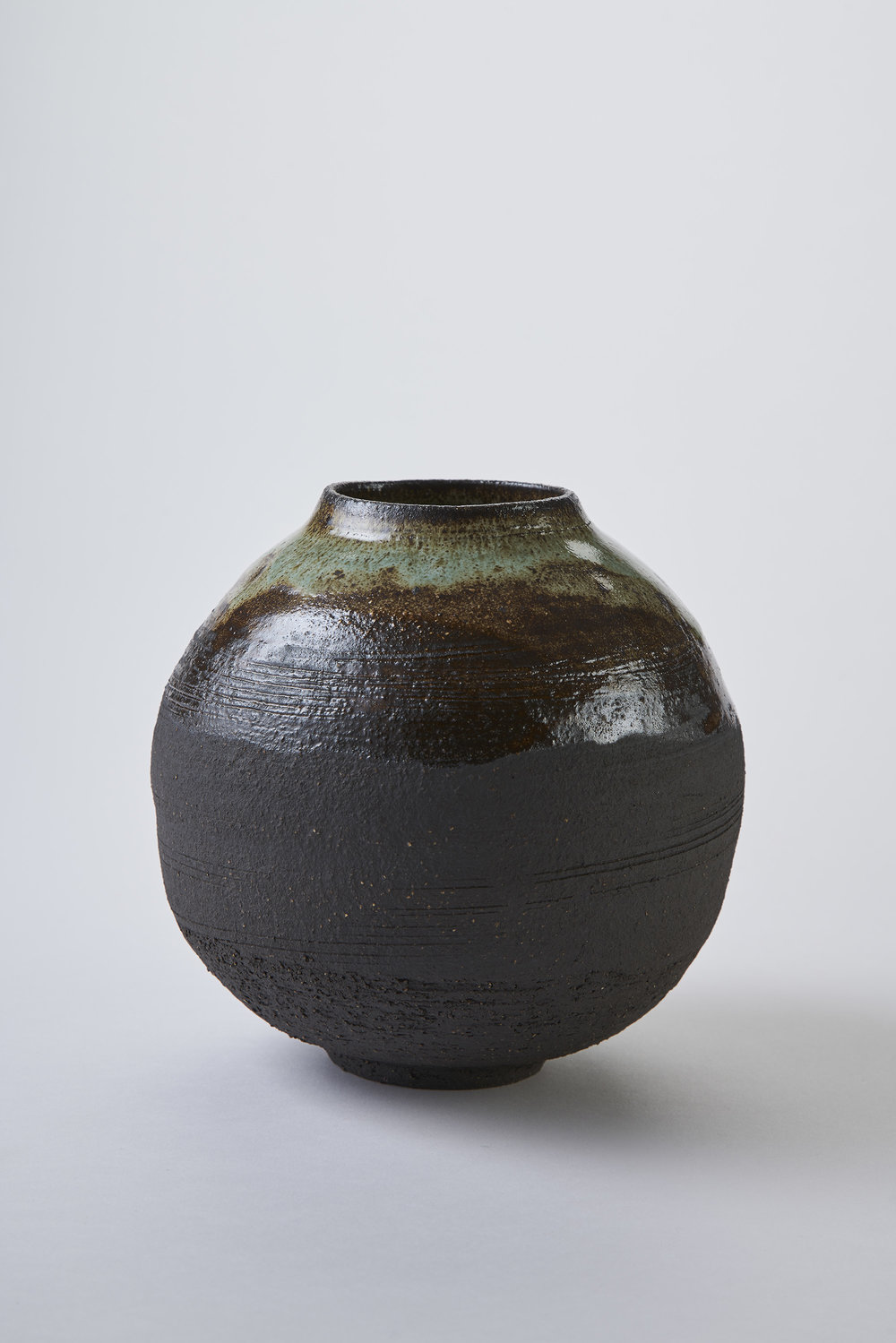 KA Ceramics Black stoneware moon jar with copper gloss glaze and dol and tin glaze, 6.5cm x 17cm. Matthew Booth Photography.jpg