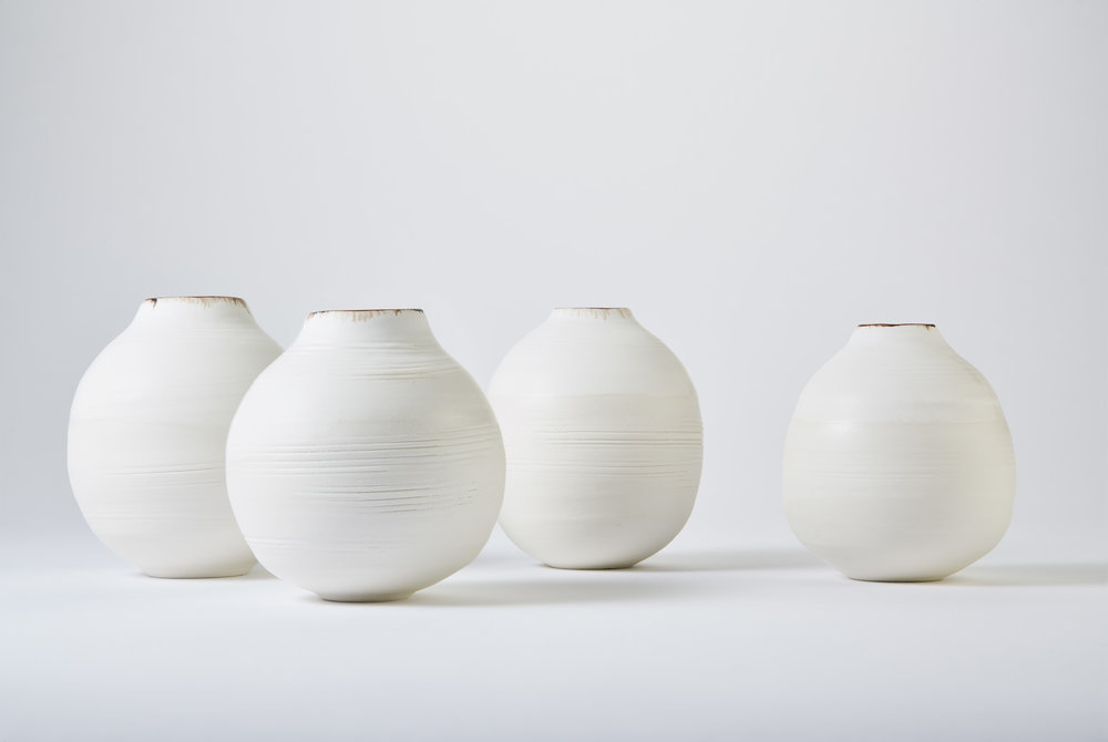 KA Ceramics Porcelain moon jars, dolomite and tin, bronze and oxide rim. Small 3.5cm x 11.5cm and 3cm x 11cm. Matthew Booth photography.jpg