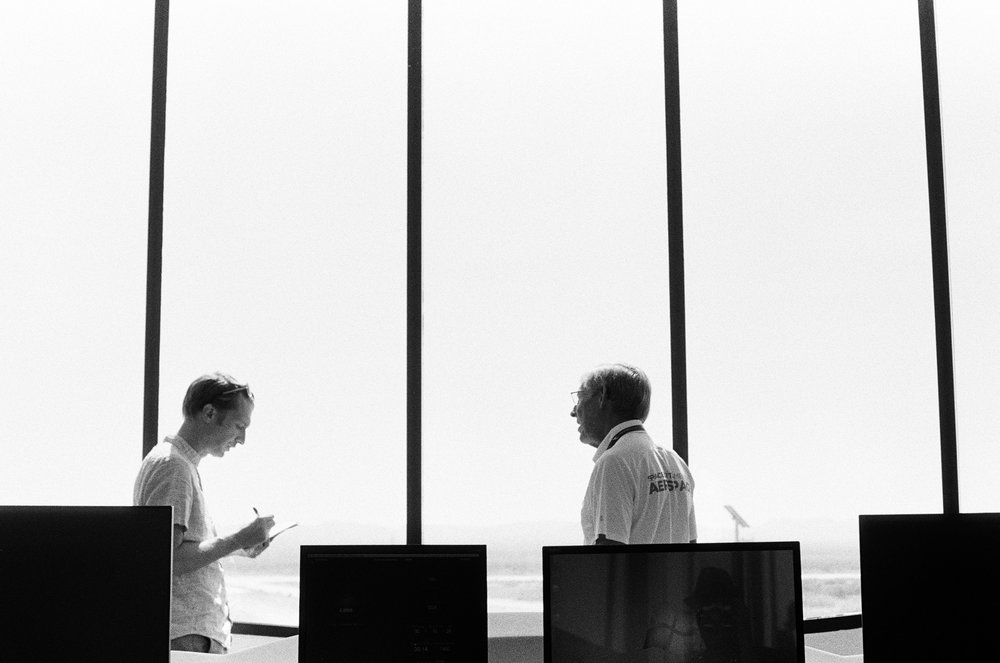 Jason Davis (left) speaks with Bill Gutman, Spaceport America's VP of operations.  Porter McDonald (35 mm B&W)