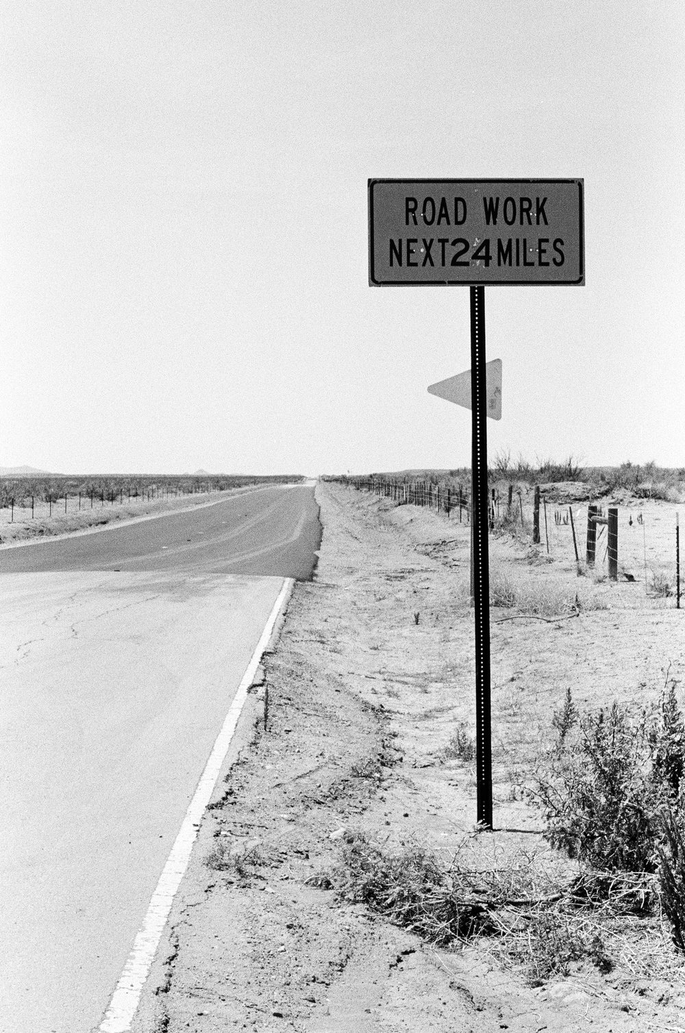The road from Spaceport America to Las Cruces, New Mexico is nearing completion.  Porter McDonald (35 mm B&W)