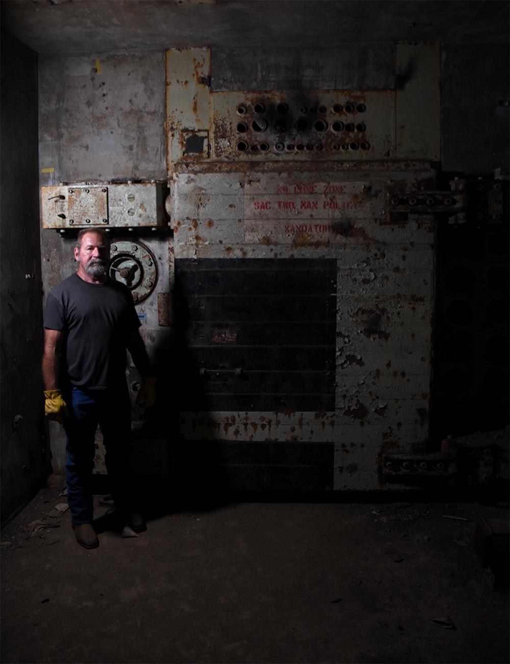 Rick Ellis stands next to one of the 6,000-pound blast doors. © Porter McDonald