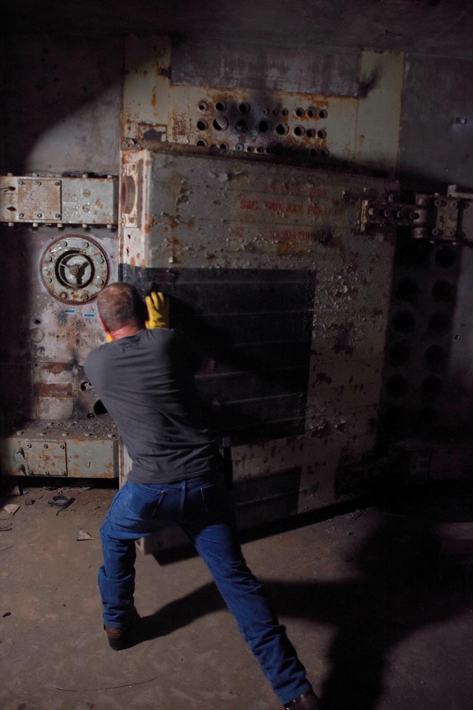 Rick Ellis slams one of the 6,000-pound blast doors. © Porter McDonald