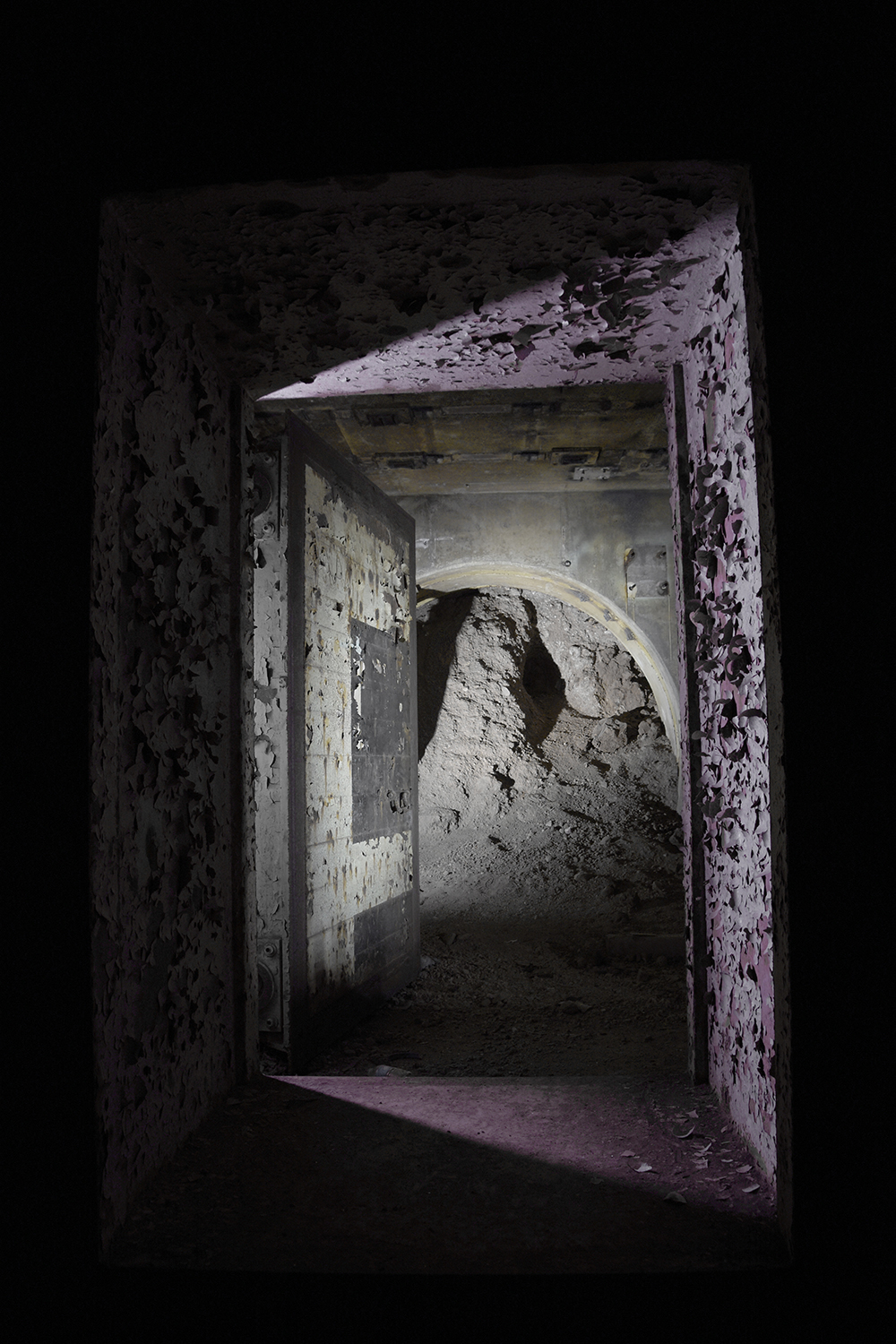 The tunnel leading to the missile silo itself, which was deliberately caved in by the Air Force. © Porter McDonald