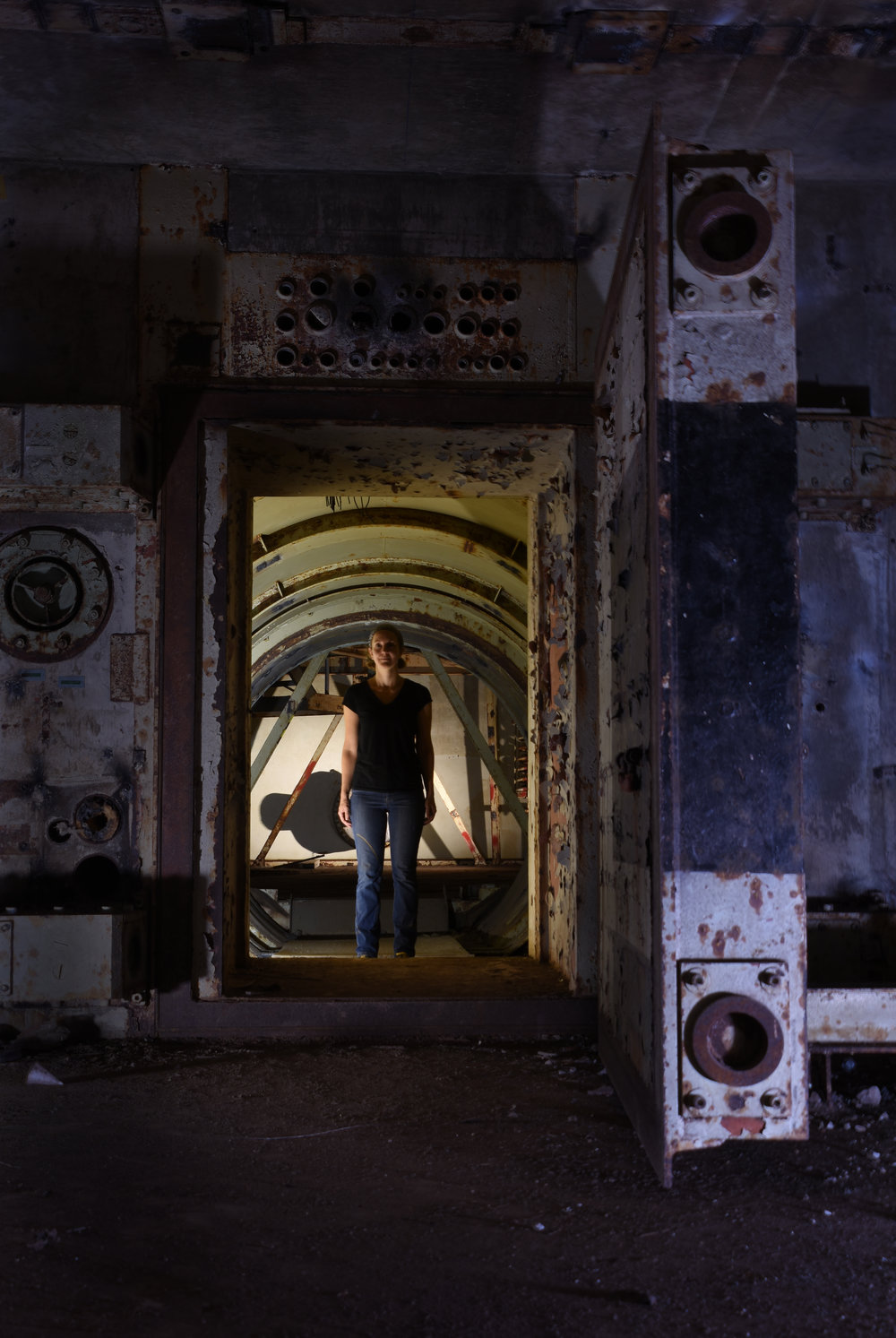Leigh McDonald stands in the tunnel connecting the blast lock and control center. © Porter McDonald