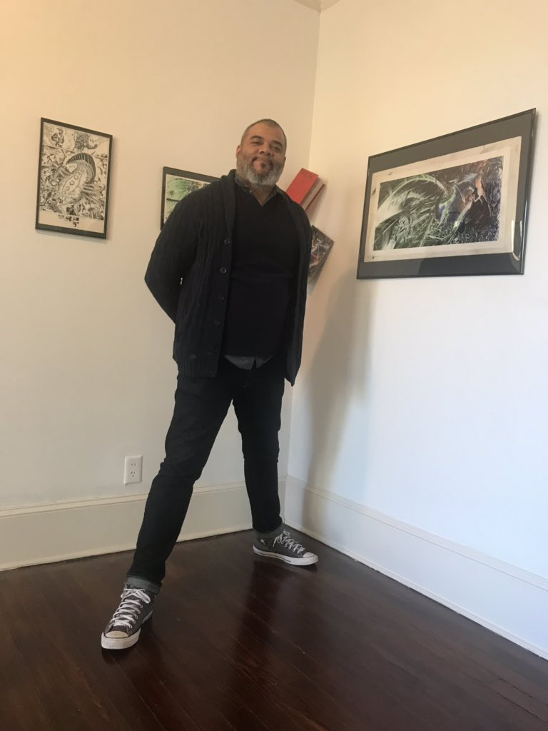 Tim Fielder, last year at his show ' Black Metropolis: 30 Years of Afrofuturism, Comics, Music, Animation, Decapitated Chickens, Heroes, Villains, and Negroes .' The show is a career retrospective of Fielder's work. Credit:  Ciaran Quinn