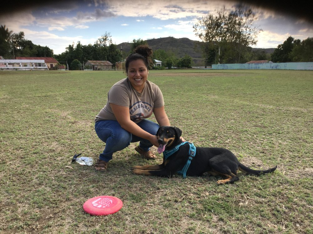 Zaira and her pet Luna playing in her community baseball field.