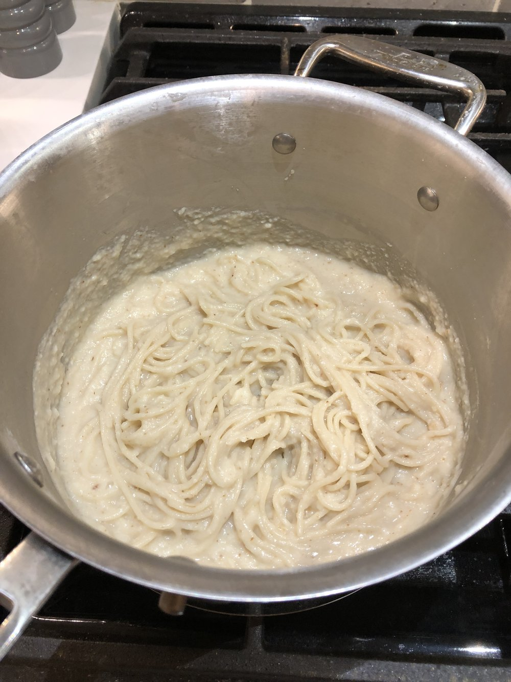 almonds and asana cauliflower alfredo with spaghetti.JPG