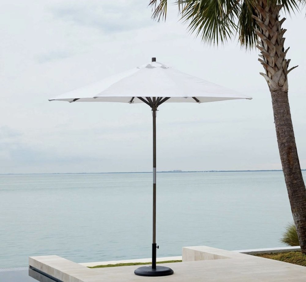 It's going to be important to be able to get some respite from the sun on our sunny roofdeck so an umbrella is a must. We love that this one is simple and elegent.