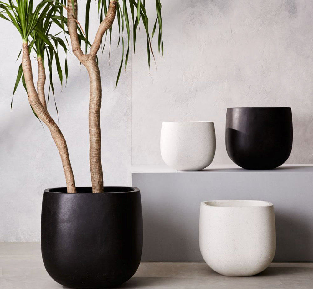 We will definitely be including some greenery up there (maybe even an eventual garden???) but for now I am all about these super simple and sleek planters!