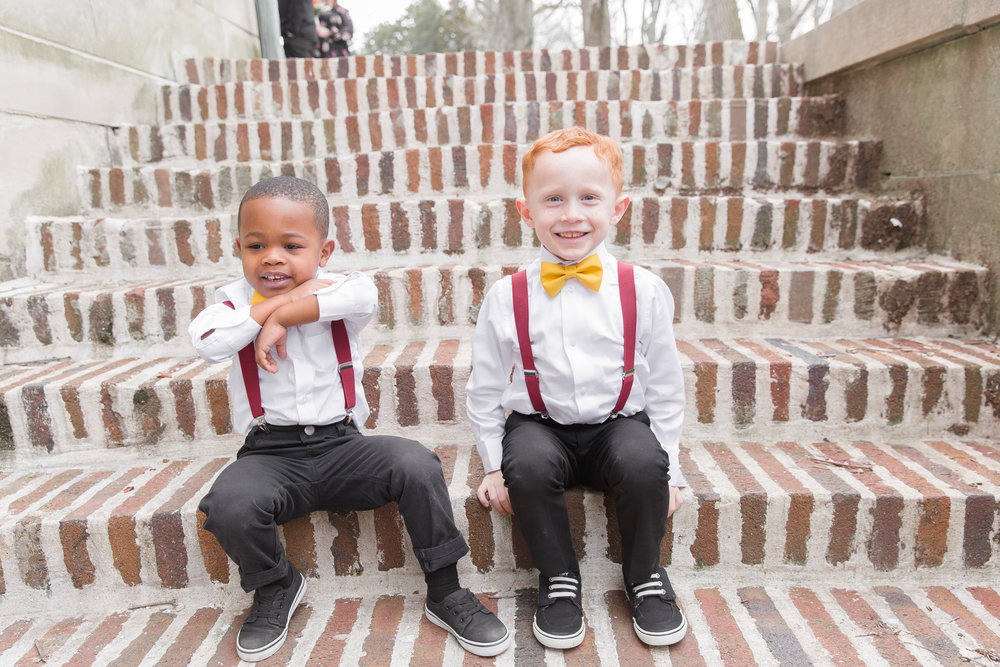 ring bearers sitting on steps in downtown indianapolis