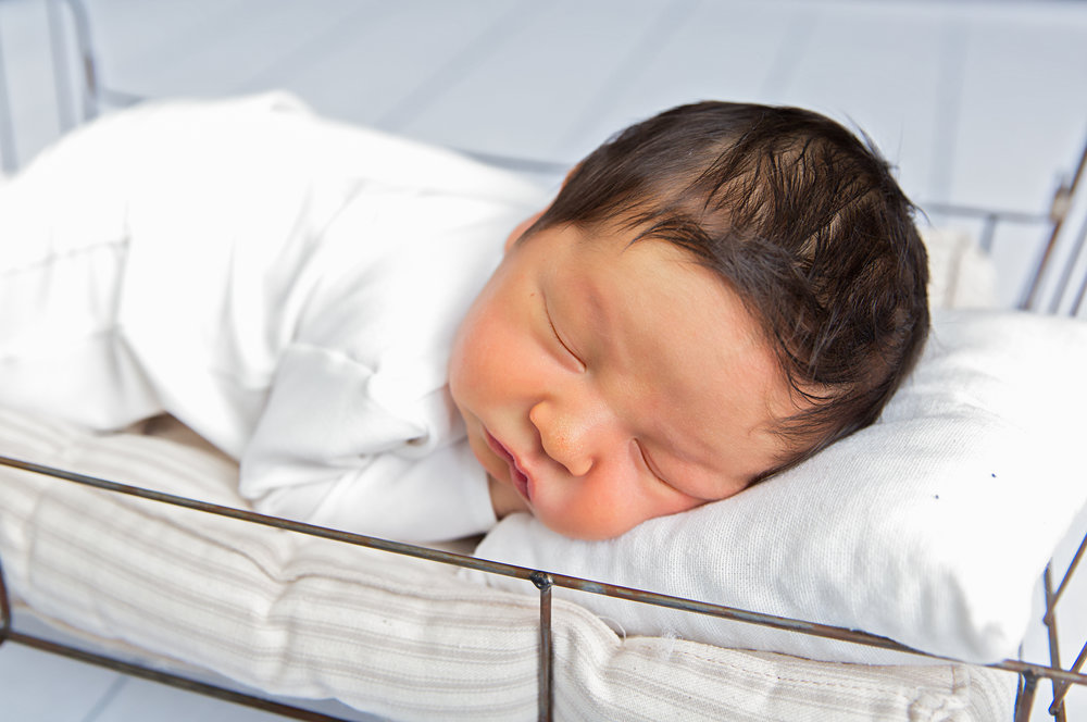 newborn baby boy posed sleeping