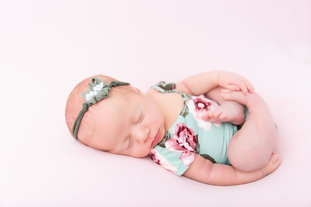 posed newborn baby sleeping