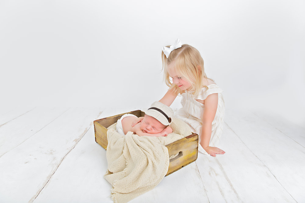 newborn baby and big sister in prop
