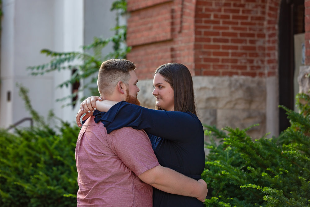 couple's engagement session looking lovingly at one another
