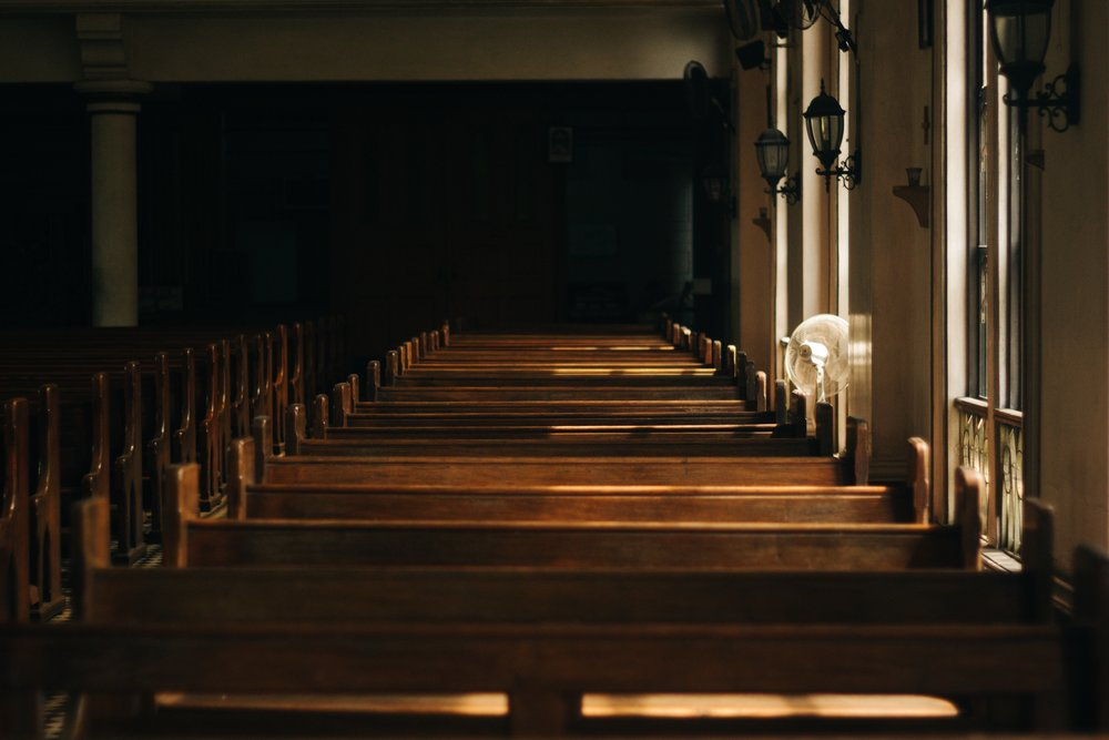 Empty Wooden Pews in Sanctuary