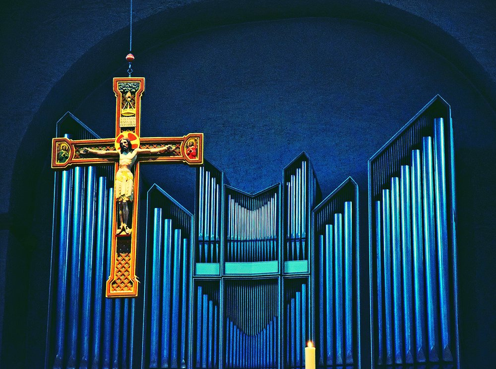 Cross before Pipe Organ in Church