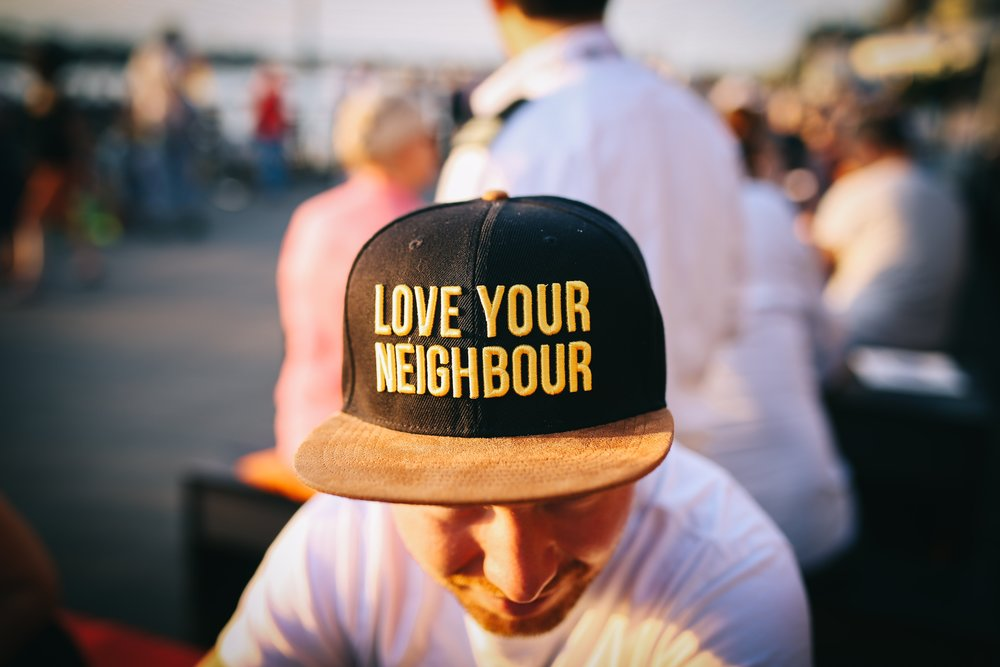 Young Man with Love Your Neighbor Cap