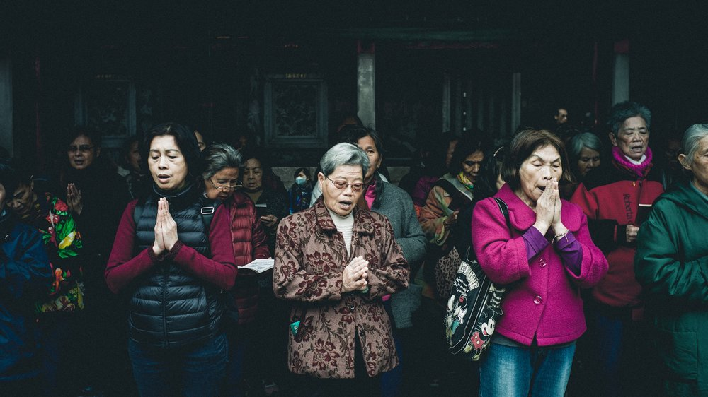 Asian Congregation in Prayer Standing