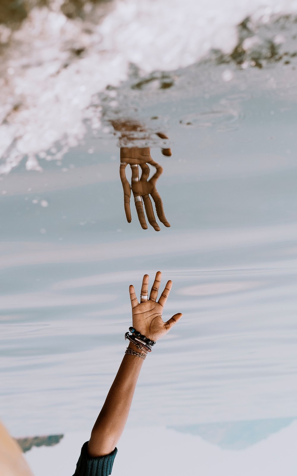 Hand Reaching to Water (Baptism Image)