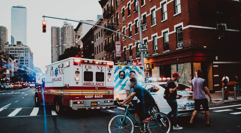 Ambulance on busy street in the United States.