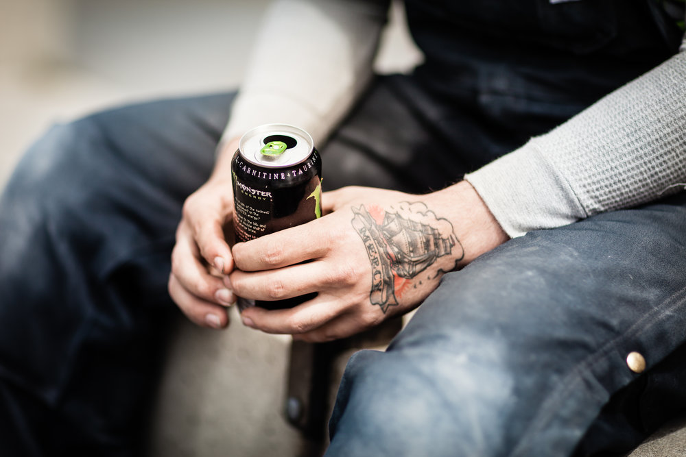 Man holding soda can.