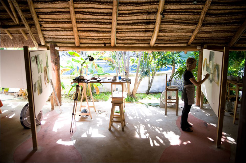 Here I am painting in an open air palapa in the Yucatan, Mexico.       Photo courtesy of Ali Goodwin