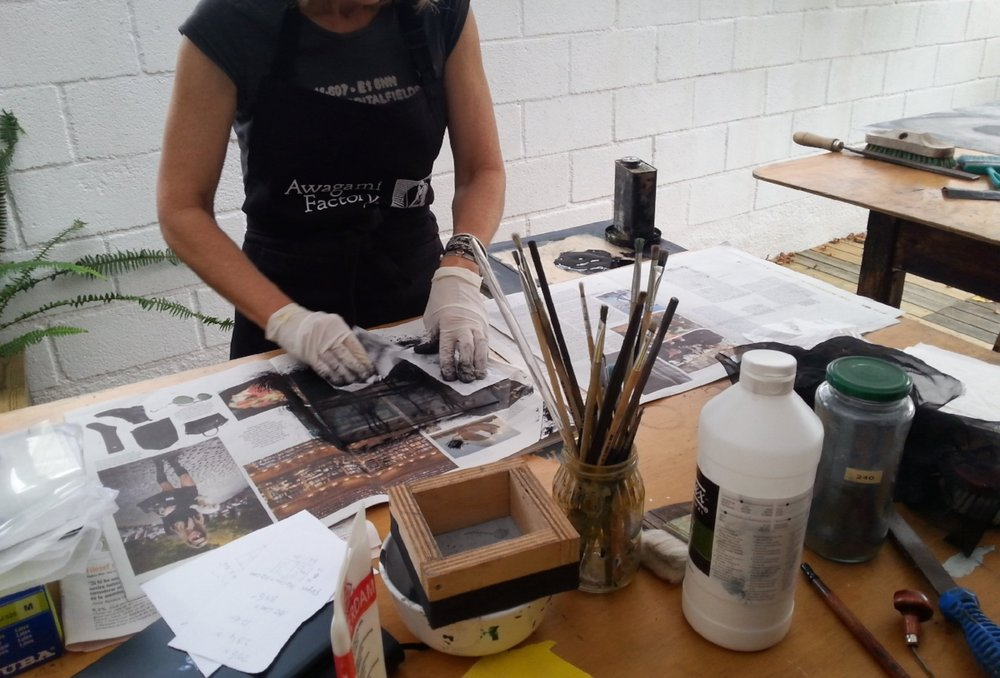 Cleaning off my carborundum plates for printing.