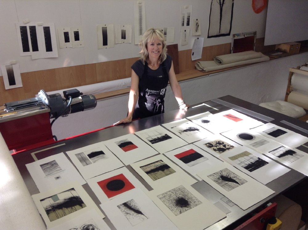 Lording it over my final body of work - carborundum and collagraph etchings. The printing press I'm leaning on is 8' long!
