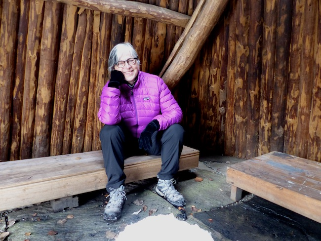 Sitting in a Sami kåta (tipi), Ricklundgarden, Southern Lapland, Sweden