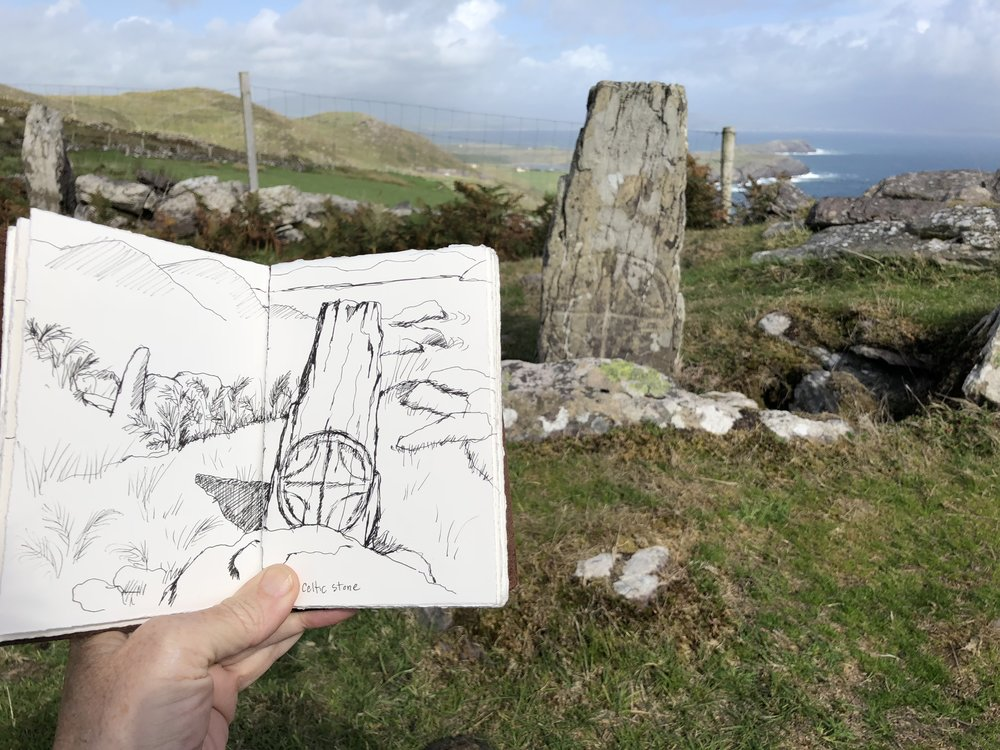 Sketching the stones nearby.