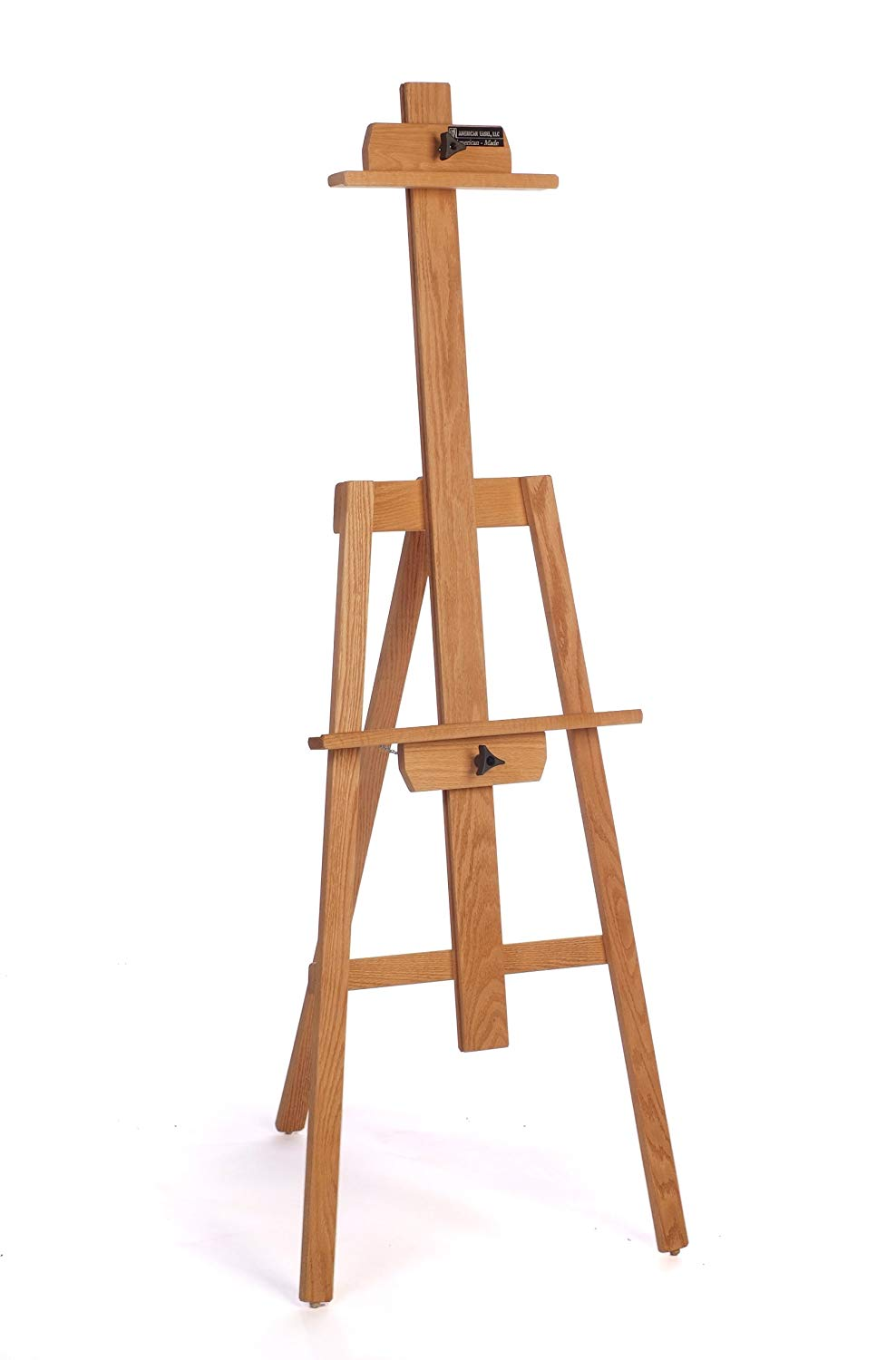 American Easel Oak Yazhi Easel-Golden Finish   This is a great sturdy stand up easel for painting on medium/large canvases or panels. I've had mine for at least 20 years and it still works perfectly. It folds up relatively flat for carrying in your car when going on painting road trips. It's fully adjustable and can support canvases and panels of most sizes.