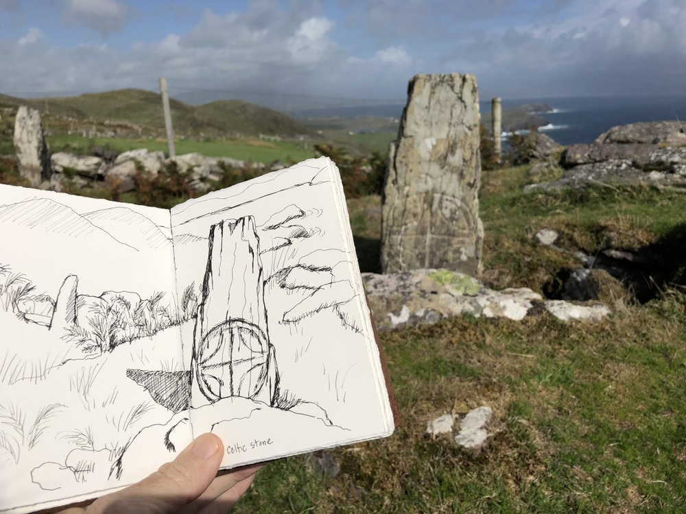 sketching the ancient stones by the cliff edge.